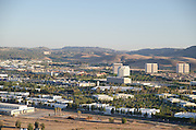 Irvine Spectrum And Business Buildings With Saddleback Mountains In The Background