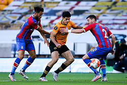 Raul Jimenez of Wolverhampton Wanderers takes on Andros Townsend of Crystal Palace and Joel Ward of Crystal Palace - Mandatory by-line: Robbie Stephenson/JMP - 20/07/2020 - FOOTBALL - Molineux - Wolverhampton, England - Wolverhampton Wanderers v Crystal Palace - Premier League