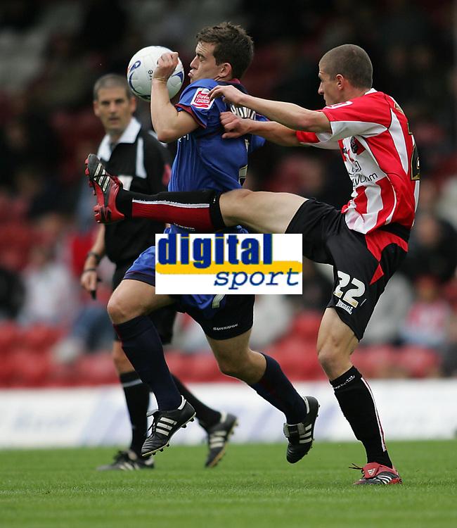 Photo: Lee Earle.<br /> Brentford v Bradford City. Coca Cola League 1. 02/09/2006. Bradford's Steven Schumacher (L) clashes with John Mousinho.
