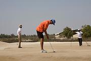 Abu Dhabi, United Arab Emirates (UAE). March 20th 2009..Al Ghazal Golf Club.<br /> 36th Abu Dhabi Men's Open Championship.<br /> Abdulla Al Musharrekh (left) and Simon Dunn (putting)