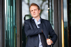 © Licensed to London News Pictures. 22/02/2017. London, UK. DAN WARNE, Deliveroo's managing director in UK and Ireland leaves after a select committee hearing on self-employment and the gig economy at Portcullis House as representatives from Uber, Amazon, Deliveroo and Hermes were asked to inform the Work and Pensions Committee in London on 22 February 2017. Photo credit: Tolga Akmen/LNP