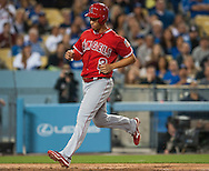 The Angels' Andrelton Simmons scores during a three-run seventh inning during their Freeway Series game Friday night at Dodger Stadium.<br /> <br /> <br /> ///ADDITIONAL INFO:   <br /> <br /> freeway.0402.kjs  ---  Photo by KEVIN SULLIVAN / Orange County Register  --  4/1/16<br /> <br /> The Los Angeles Angels take on the Los Angeles Dodgers at Dodger Stadium during the Freeway Series Friday.<br /> <br /> <br />  4/1/16