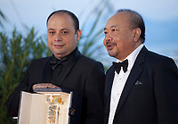 Cesar Diaz, winner of the Camera d'Or award for the film Nuestras Madres and President of the Camera d'or Jury Rithy Panh at the Palme D'Or Award photo call at the 72nd Cannes Film Festival, Saturday 25th May 2019, Cannes, France. Photo credit: Doreen Kennedy
