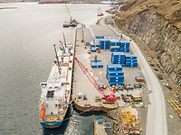 Aerial view of a shipping boat in harbour in Alaska, USA.