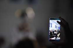 August 19, 2017 - Toronto, Ontario, Canada - A spectator taking picture with his cell phone during the 4th day of African Fashion Week in Toronto, Canada on 19 August 2017. (Credit Image: © Arindam Shivaani/NurPhoto via ZUMA Press)