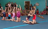 """Gymmy's"" Rory Rousseau, Catherine Fay, Mary Louise Banker, Gracie Stephen, Sasha Kiel and Lyla McSheffrey do the caterpiller during their floor time at Lakes Region Gymnastics Friday evening.  (Karen Bobotas/for the Laconia Daily Sun)"