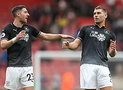Burnley's Stephen Ward (left) and Sam Vokes