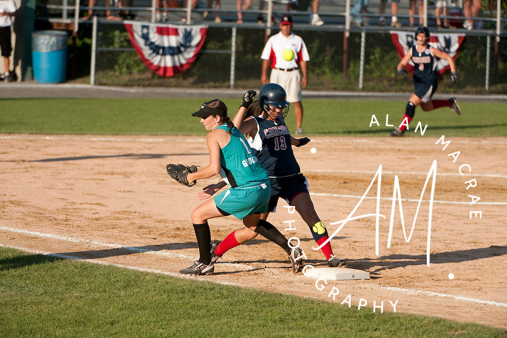 Concord's Marciana Longley makes it safely to first as Berkshire Force's first baseman Jennifer Grogan loses the ball during last night's game at Doane Field.  (Alan MacRae/for the Monitor)