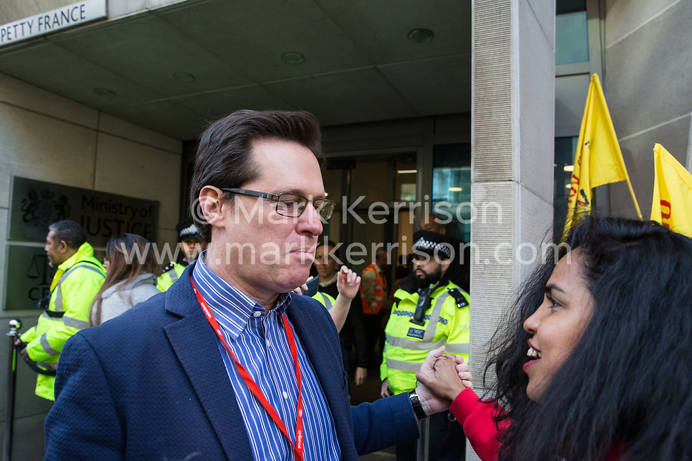 London, UK. 26th February, 2019. Austin Harney from the National Executive Committee of the Public and Commercial Services Union (PCS) takes part in a 'Clean Up Outsourcing' demonstration to call for an end to the practice of outsourcing by mainly migrant striking outsourced workers belonging to the Independent Workers of Great Britain (IWGB), United Voices of the World (UVW) and PCS trade unions working at the University of London (IWGB), Ministry of Justice (UVW) and Department for Business Energy and Industrial Strategy (PCS), together with representatives of the National Union of Rail, Maritime and Transport Workers (RMT) Regional Council. The demonstration was organised to coincide with a significant High Court hearing of an application by the IWGB for judicial review of a decision by the Central Arbitration Committee (CAC) not to hear their application for trade union recognition for the purposes of collective bargaining with the University of London.