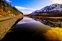 Relections of snowcapped mountains, along the road from Anchorage to Seward, Alaska USA