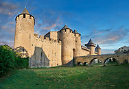 Carcassonne medieval historic fortifications and battlement walls of Carcassonne castle, CarcassonneFrance . The medieval citadel of Carcassonne, known as the Cité de Carcassonne, is a medieval fortress dating back to the Gallo-Roman period and restored by the theorist and architect Eugène Viollet-le-Duc in 1853. It was added to the UNESCO list of World Heritage Sites in 1997. The fortified city of Carcassonne consists essentially of a concentric design of two outer walls with 53 towers and barbicans to prevent attack by siege engines. Carcassonne  castle itself possesses its own drawbridge and ditch leading to a central keep. The walls of Carcassonne consist of towers built over quite a long period. One section is Roman and is notably different from the medieval walls.<br /> <br /> <br /> Visit our MEDIEVAL PHOTO COLLECTIONS for more   photos  to download or buy as prints https://funkystock.photoshelter.com/gallery-collection/Medieval-Middle-Ages-Historic-Places-Arcaeological-Sites-Pictures-Images-of/C0000B5ZA54_WD0s