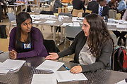 Purchase, NY – 31 October 2014. Yonkers Montessori team members Chinnu Thomas, left, and Samantha Valenti discuss the case study. The Business Skills Olympics was founded by the African American Men of Westchester, is sponsored and facilitated by Morgan Stanley, and is open to high school teams in Westchester County.
