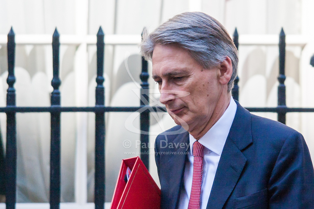 Downing Street, London, August 13th 2014. British Foreign Secretary Philip Hammond leaves 10 Downing Street after chairing a COBR committee meeting over the crisis in Iraq.
