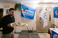 LUGO, ITALY - 5 JANUARY 2020: A waiter is seen here working at the League party dinner attended by Matteo Salvini, former Interior Minister of Italy and leader of the far-right League party, in Lugo, Italy, on January 5th 2020.<br /> <br /> Matteo Salvini is campaigning in the region of Emilia Romagna to support the League candidate Lucia Borgonzoni running for governor.<br /> <br /> After being ousted from government in September 2019, Matteo Salvini has made it a priority to campaign in all the Italian regions undergoing regional elections to demonstrate that, in power or not, he still commands considerable support.<br /> <br /> The January 26th regional elections in Emilia Romagna, traditionally the home of the Italian left, has been targeted by Matteo Salvini as a catalyst for bringing down the government. A loss for the center-left Democratic Party (PD) against Mr Salvini's right would strip the centre-left party of control of its symbolic heartland, and probably trigger a crisis in its coalition with the Five Star Movement.