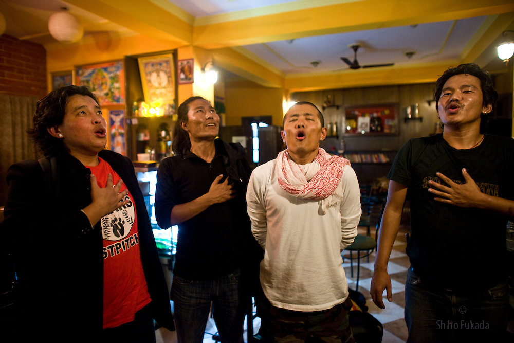 INDIA - Life in Exile (Tibetan Refugees) <br /> Young Tibetans sing Gyallu, the national anthem of Tibet, as they party at a cafe in McLeod Ganj, Dharamsala, India, where the Dalai Lama settled after fleeing Tibet in 1959 after a failed uprising against Chinese rule, May 30, 2009.