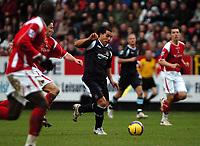 Photo: Tony Oudot.<br />Charlton Athletic v West Ham United. The Barclays Premiership. 24/02/2007.<br />Carlos Tevez of West Ham goes past the Charlton defence