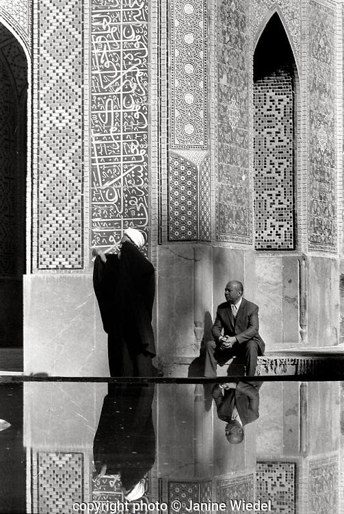 Mullah praying outside Mosque in Esfahan ( Isfahan ) Iran 1970s