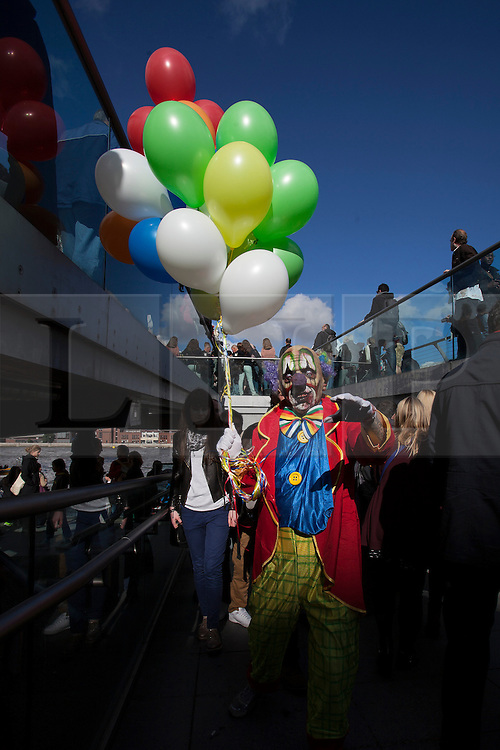 © licensed to London News Pictures. London, UK 13/10/2012. A man with zombie costume and make-up walking on Millennium Bridge as more than 2,000 'zombies' celebrating World Zombie Day on 13/10/12 in London. Photo credit: Tolga Akmen/LNP