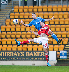 St Johnstone's Frazer Wright and Ross County's Paul Quinn.<br /> St Johnstone 2 v 1 Ross County, Scottish Premiership 22/11/2014 at St Johnstone's home ground, McDiarmid Park.