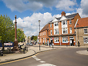 Buildings and war memorial in the Market Place in Thetford, Norfolk, England