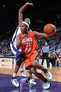 Oklahoma State guard Danielle Green (31) drives around pressure from Kansas State's Shana Wheeler, during first half action at Bramlage Coliseum in Manhattan, Kansas, February 28, 2007.  Oklahoma State beat K-State 64-55.