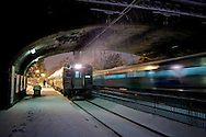 At Mountain Station, a New York bound train is stopped to pick up passengers while on the westbound track a Dover train slows to do the same.