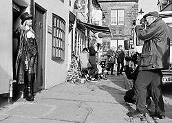 © Licensed to London News Pictures.01/11/15<br /> Whitby, UK. <br /> <br /> A woman poses for pictures as hundreds of visitors attend the Whitby Goth weekend in Whitby, North Yorkshire. The event began in 1994 to celebrate goth culture and music and takes place twice each year. <br /> Thousands of extravagantly dressed people attend the popular event wearing Steampunk, Cybergoth, Romanticism, Victoriana and other clothing as they take part in the celebration of Goth culture. <br /> <br /> Note to Editors - Picture shot on Kodak Tri X 400ISO film.<br /> Photo credit : Ian Forsyth/LNP