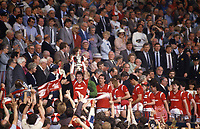 Football - 1985 FA Cup Final - Manchester United 1 Everton 0<br /> <br /> United captain Bryan Robson lifts the trophy at the top of the Wembley steps.<br /> <br /> 18/05/1985