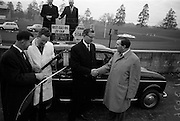 17/3/1966<br /> 3/17/1966<br /> 17 March 1966<br /> <br /> Mr. Con Smith (right) Congragulating Mr Pierce Roche on winning the Dealers 4L Renault Economy Test Competition with a return of 50Mpg. On the Left is Jerry O'Meana and Patrick Simpson who Conducted the Test