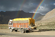 India, Serchu night camp, between Manali and Leh, Kullu District, Himachal Pradesh, Northern India, A truck and a rainbow in the background