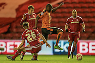 Jérémy Hélan (Wolverhampton Wanderers) jumps over a challenge by Tomáš Kalas (on loan from Chelsea) (Middlesbrough) during the Sky Bet Championship match between Middlesbrough and Wolverhampton Wanderers at the Riverside Stadium, Middlesbrough, England on 4 March 2016. Photo by Mark P Doherty.