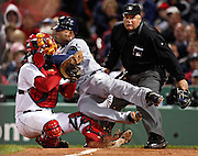 SP_295919_CASS_rays_13<br /> BRIAN CASSELLA   |   Times<br /> (10/13/2008 BOSTON) Carl Crawford collides with Red Sox catcher Jason Varitek during the 8th inning. Crawford was trying to score from third and was out on the play.<br /> <br /> <br /> MAJOR LEAGUE BASEBALL - Tampa Bay Rays vs Boston Red Sox at Fenway Park in Game 3 of the ALCS on Monday (10/13/08).