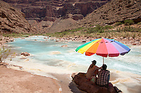 People enjoying the Little Colorado River while rafting the Grand Canyon. Grand Canyon National Park, AZ.