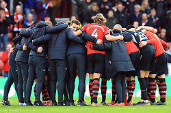 Southampton players and staff during a post match huddle after the final whistle