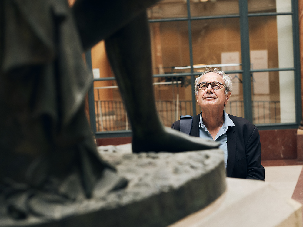 Jean-Paul Demoule, prehistorian & archeologist, posing in a corridor at the Institut National d'Histoire de l'Art, standing next to a statue of Eurydice. Paris, France. September 23, 2020. <br /> Jean-Paul Demoule, prehistorien & archeologiste, prenant la pose dans un couloir de l'Institut National d'Histoire de l'Art, a cote d'une statue d'Eurydice. Paris, France. 23 septembre 2020.