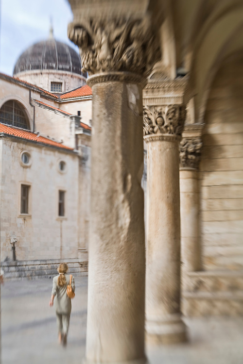 Europe, Croatia, Dalmatia, Dubrovnik.  Stone columns at entrance to Rector's Palace (15th century).  The historic center of Dubrovnik is a UNESCO World Heritage site.
