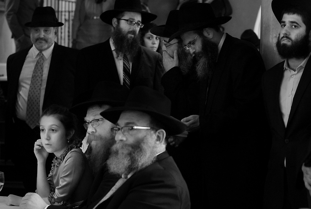 During the first Chassidic wedding ever held in Columbia, S.C. Chassidic jews from across the nation look on as the groom signs the marriage contract before the actual wedding ceremony.