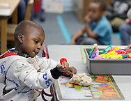 Jeremiah Farmer uses play dough in a Head Start class at North Congregational Church in Middletown on Sept. 25, 2012.