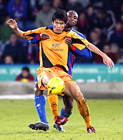 Photo: Chris Ratcliffe.<br />Crystal Palace v Wolverhampton Wanderers. Coca Cola Championship. 10/12/2005.<br />Ki-Hyeon Seol (L )of Wolves tussles with Emmerson Boyce of Palace