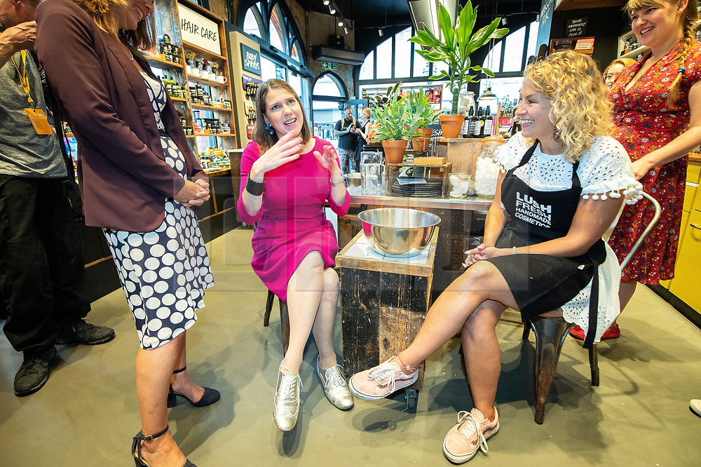 © Licensed to London News Pictures . 14/09/2019. Bournemouth, UK. Party leader JO SWINSON (in fuchsia) is given a hand skin treatment by shop manager CHARLOTTE MILLS (26) (right) during a visit to a branch of Lush in Bournemouth town centre . The first day of the Liberal Democrat Party Conference at the Bournemouth International Centre . Photo credit: Joel Goodman/LNP