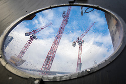 © Licensed to London News Pictures. 15/01/2018. London, UK. Carillion cranes seen through a viewing portal on a closed construction site in central London. The construction firm has gone into liquidation after losing money on big contracts and running up debts of around £1.5bn. Photo credit: Rob Pinney/LNP