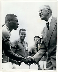 Jun. 30, 1958 - Brazil beats Sweden 5-2 to win World Cup:Photo shows King Gustaf Adolf shakes hands with the Brazilian inside left Pele before start of the match which the Brazilians won - in Stockholm. (Credit Image: © Keystone Press Agency/Keystone USA via ZUMAPRESS.com)
