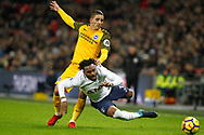 Anthony Knockaert of Brighton & Hove Albion (L) fouls Danny Rose of Tottenham Hotspur (R). Premier league match, Tottenham Hotspur v Brighton & Hove Albion at Wembley Stadium in London on Wednesday 13th December 2017.<br /> pic by Steffan Bowen, Andrew Orchard sports photography.