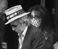Keith Richards Has High Tea At the dorchester on the way out a passing admirer gets a kiss