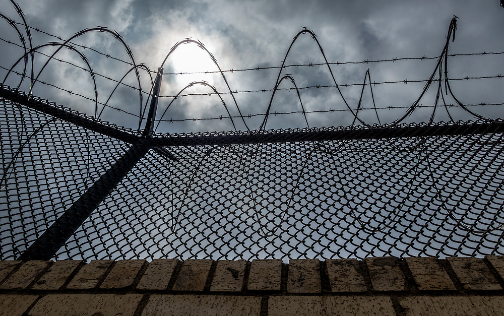Security border fence with razor wire, Brownsville, Texas, USA