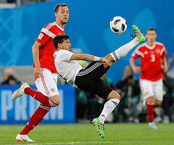 June 19, 2018 - Saint Petersburg, Russia - Artem Dzyuba (L) of Russia national team and Tarek Hamed of Egypt national team vie for the ball during the 2018 FIFA World Cup Russia group A match between Russia and Egypt on June 19, 2018 at Saint Petersburg Stadium in Saint Petersburg, Russia. (Credit Image: © Mike Kireev/NurPhoto via ZUMA Press)