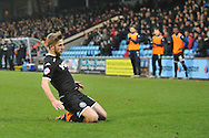 Michael Jacobs of Wigan Athletic  celebrates scoring to go 1 all  during the Sky Bet League 1 match between Scunthorpe United and Wigan Athletic at Glanford Park, Scunthorpe, England on 2 January 2016. Photo by Ian Lyall.