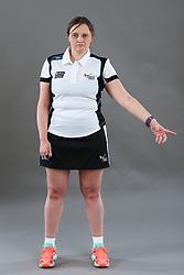 Umpire Rachael Radford signalling throw in - goal line