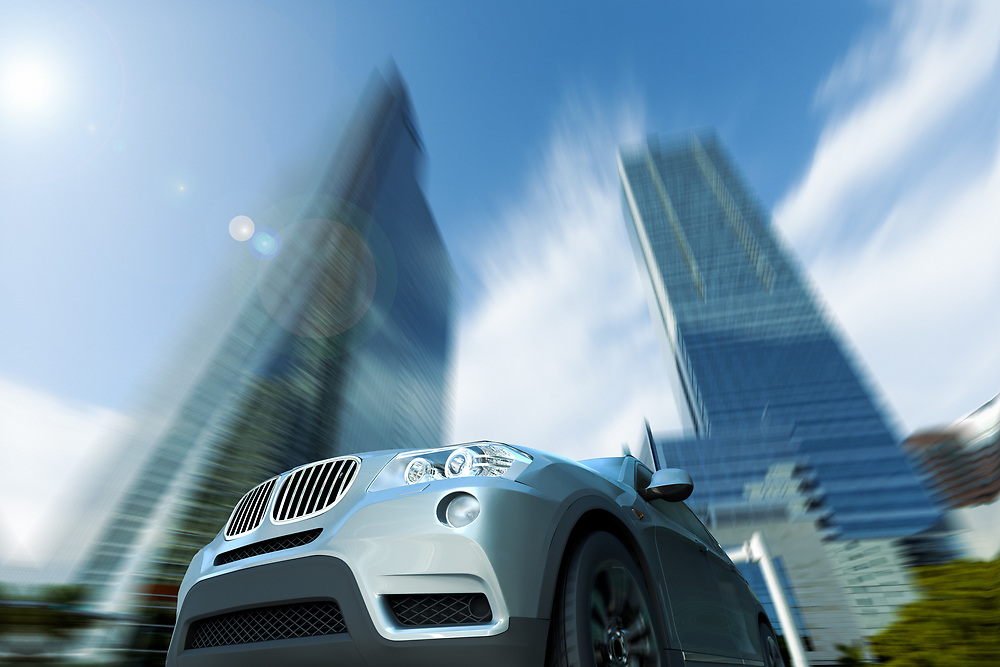 3D rendering of a sport car speeding in front of a skyline.