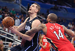 December 22, 2017 - Orlando, FL, USA - The New Orleans Pelicans' Jameer Nelson (14) fouls the Orlando Magic's Mario Hezonja, left, at the Amway Center in Orlando, Fla., on Friday, Dec. 22, 2017. The Pelicans won, 111-97. (Credit Image: © Stephen M. Dowell/TNS via ZUMA Wire)